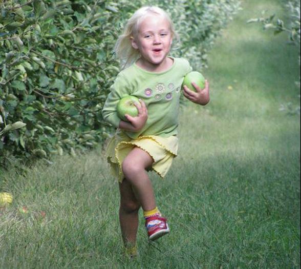 girl-running-orchard